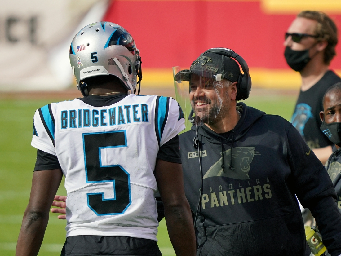 Nov 8, 2020; Kansas City, Missouri, USA; Carolina Panthers quarterback Teddy Bridgewater (5) talks with head coach Matt Rhule during the game against the Kansas City Chiefs at Arrowhead Stadium. Mandatory Credit: Denny Medley-USA TODAY Sports