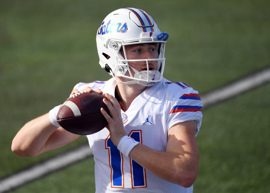 Nov 21, 2020; Nashville, Tennessee, USA;  Florida Gators quarterback Kyle Trask (11) warms up before the game against the Vanderbilt Commodores at Vanderbilt Stadium. Mandatory Credit: Christopher Hanewinckel-USA TODAY Sports