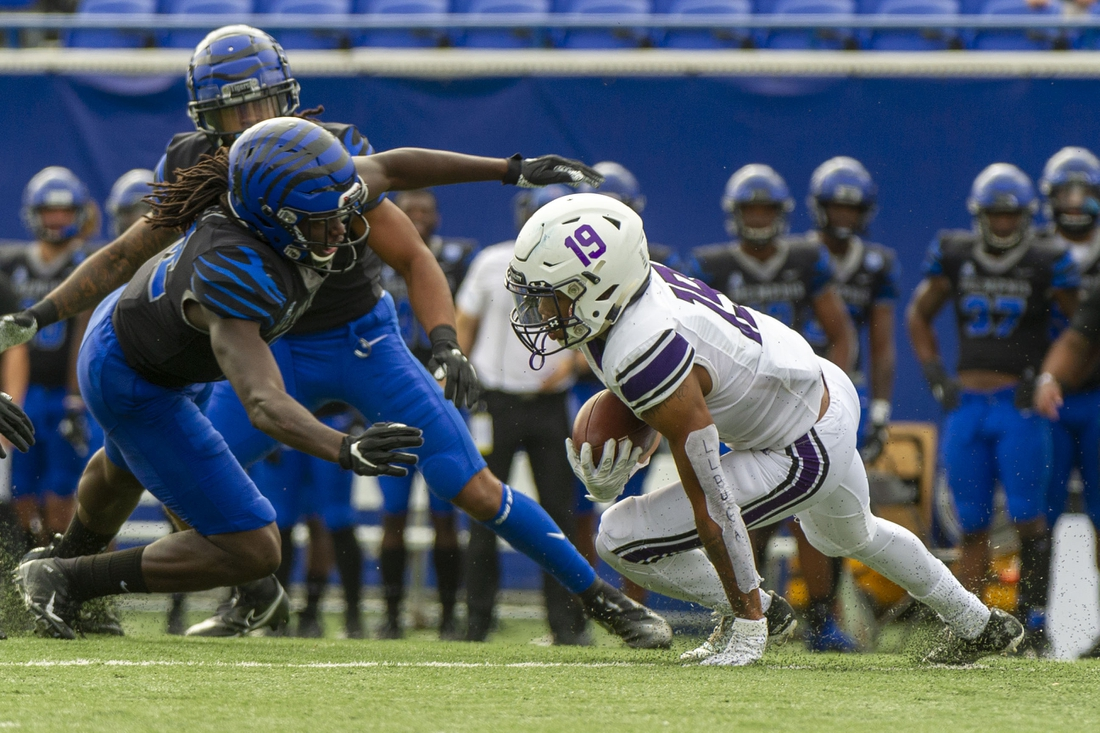 Nov 21, 2020; Memphis, Tennessee, USA; Stephen F. Austin Lumberjacks wide receiver Xavier Gipson (19) carries the ball against Memphis Tigers defensive back Tyrez Lindsey (22) during the first half at Liberty Bowl Memorial Stadium. Mandatory Credit: Justin Ford-USA TODAY Sports