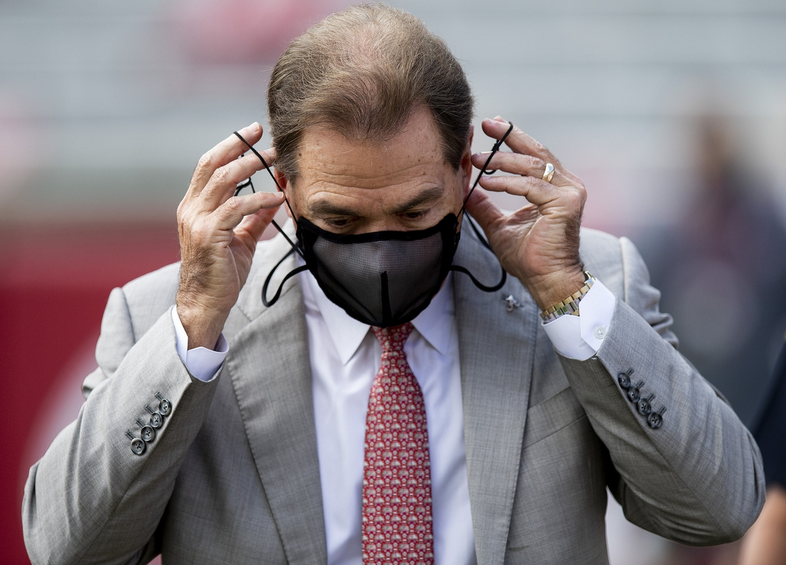 Nov 21, 2020; Tuscaloosa, Alabama, USA; Alabama head coach Nick Saban puts his mask back on after a pregame interview before the Kentucky game at Bryant-Denny Stadium. Mandatory Credit: Mickey Welsh/The Montgomery Advertiser via USA TODAY Sports