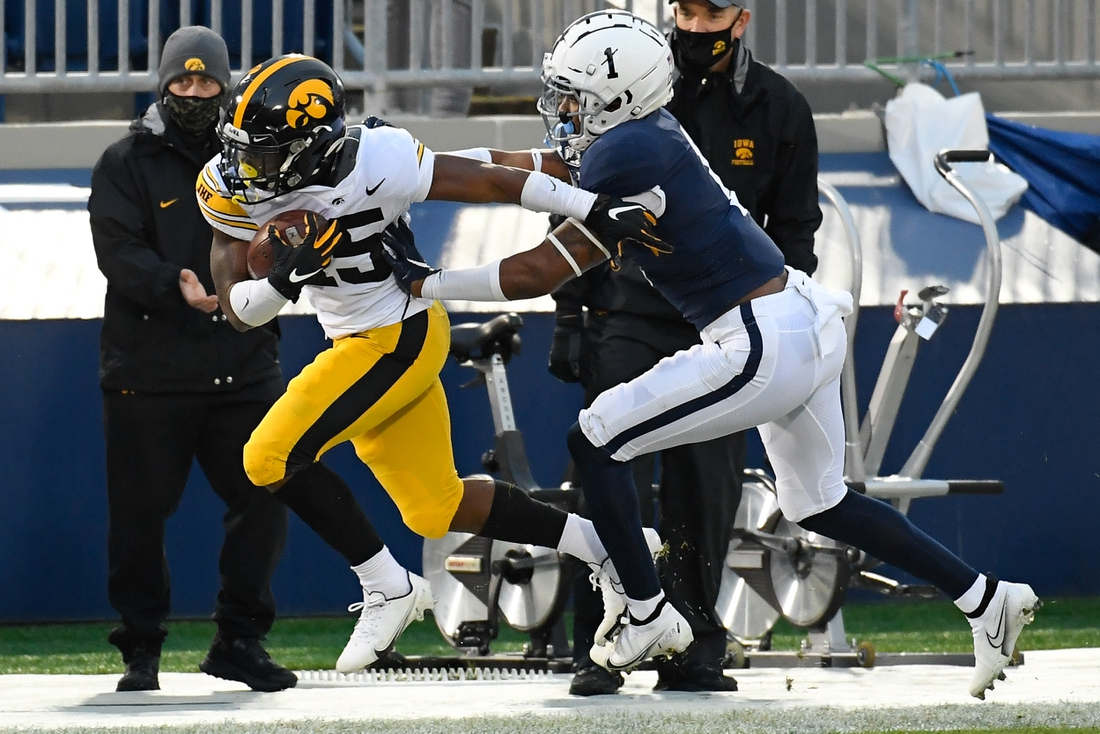 Nov 21, 2020; University Park, Pennsylvania, USA; Penn State Nittany Lions safety Jaquan Brisker (1) pushes Iowa Hawkeyes running back Tyler Goodson (15) out of bounds during the first quarter at Beaver Stadium. Mandatory Credit: Rich Barnes-USA TODAY Sports