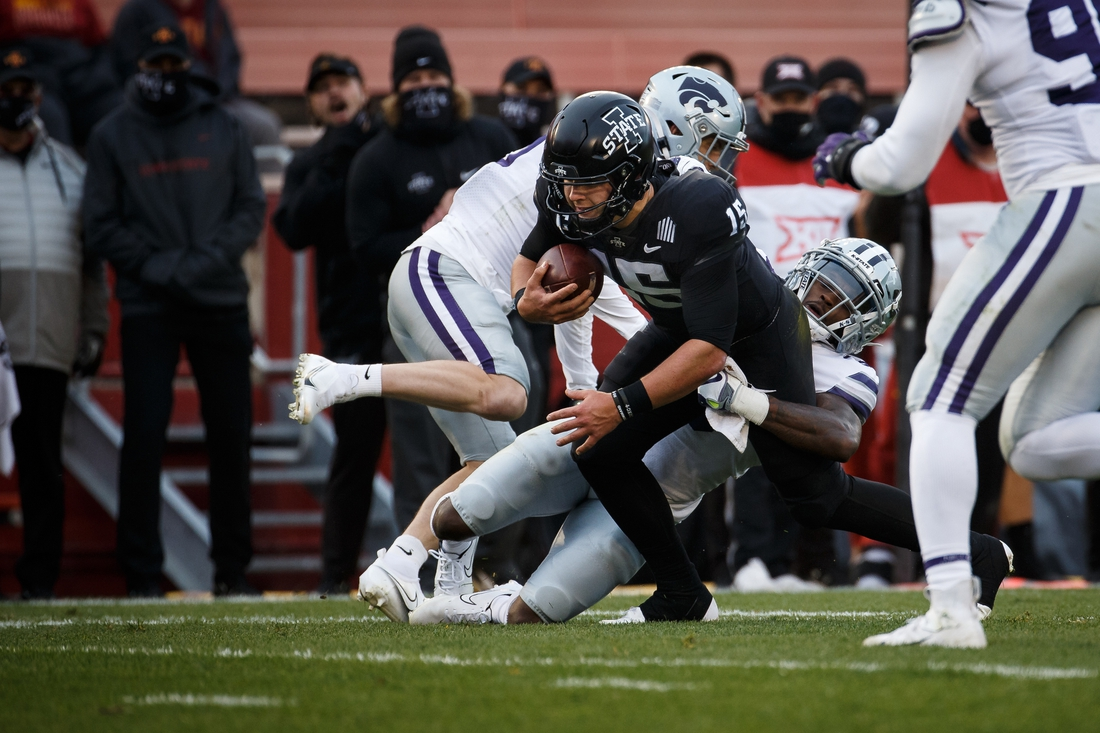 Nov 21, 2020; Ames, Iowa, USA;  Iowa State quarterback Brock Purdy (15) is tackled by Kansas State senior Defensive Back Kiondre Thomas (3) during their football game at Jack Trice Stadium. Mandatory Credit: Brian Powers-USA TODAY Sports