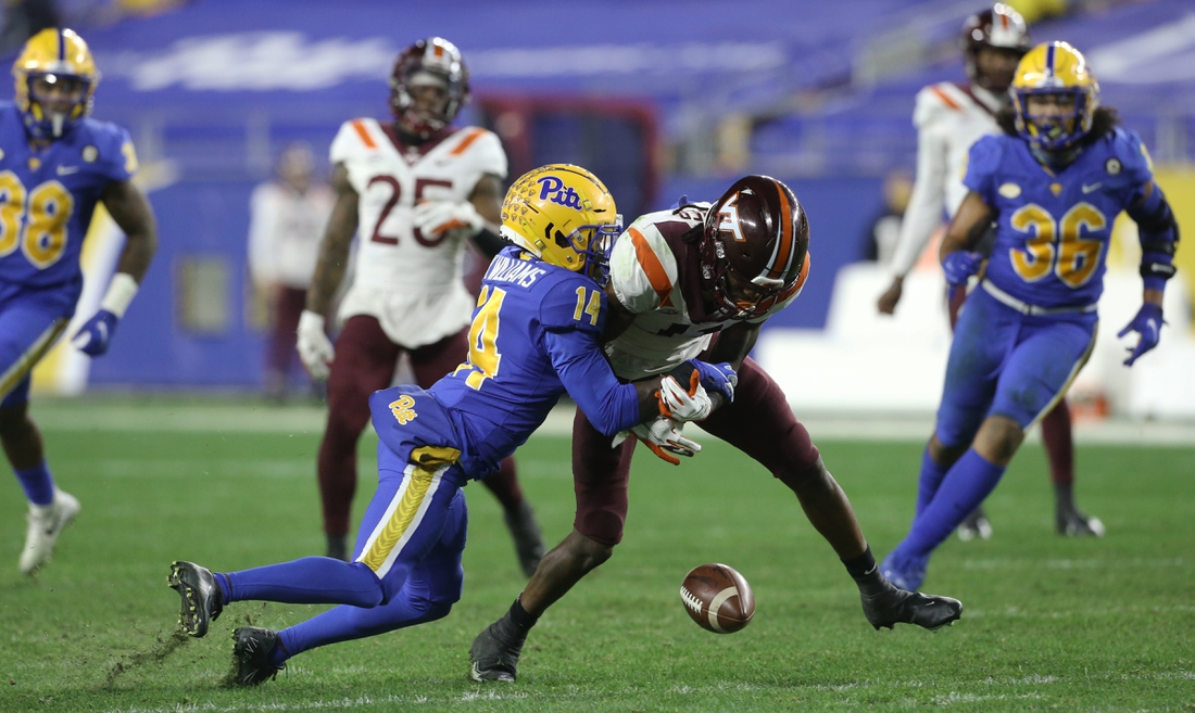 Nov 21, 2020; Pittsburgh, Pennsylvania, USA;  Pittsburgh Panthers defensive back Marquis Williams (14) breaks up a pass intended for Virginia Tech Hokies wide receiver Tre Turner (11) during the second quarter at Heinz Field. Mandatory Credit: Charles LeClaire-USA TODAY Sports