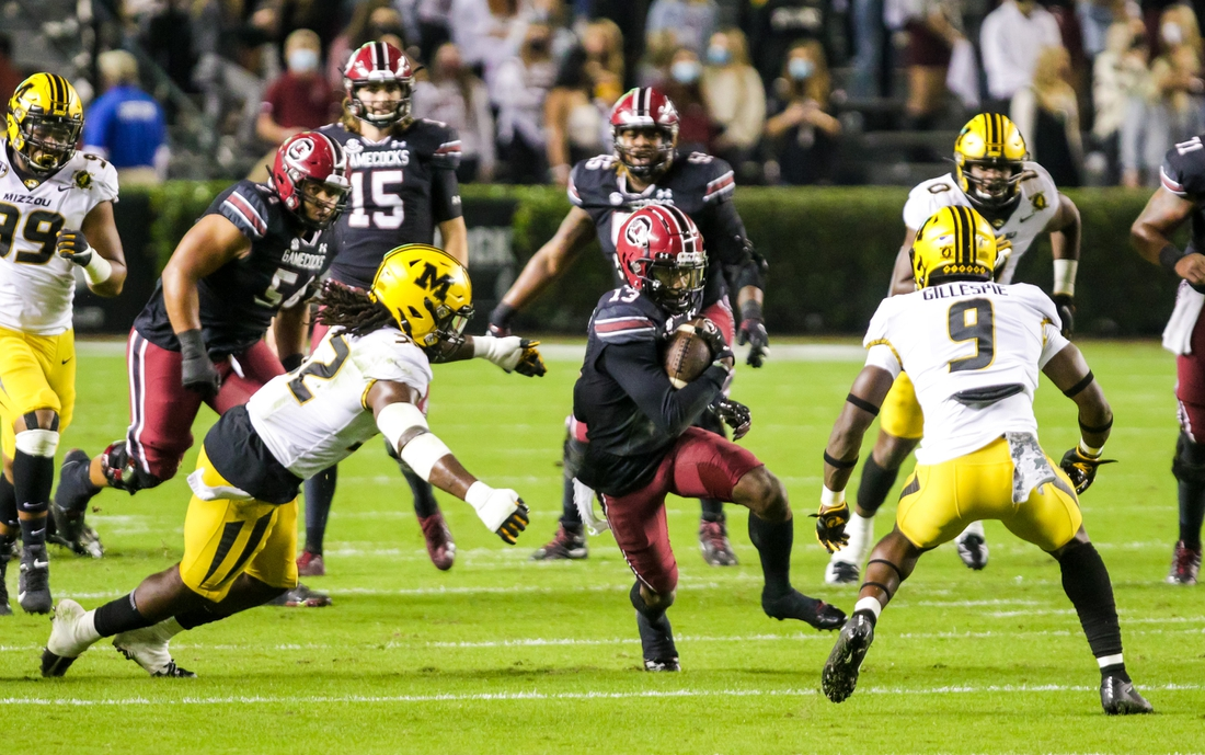 Nov 21, 2020; Columbia, South Carolina, USA; South Carolina Gamecocks wide receiver Shi Smith (13) runs the ball against Missouri Tigers defensive back Ennis Rakestraw Jr. (2) and safety Tyree Gillespie (9) in the first quarter at Williams-Brice Stadium. Mandatory Credit: Jeff Blake-USA TODAY Sports