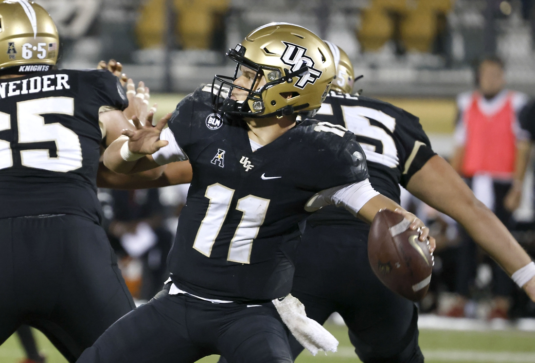 Nov 21, 2020; Orlando, Florida, USA; UCF Knights quarterback Dillon Gabriel (11) drops to throw a pass during the second half against the Cincinnati Bearcats at the Bounce House. Mandatory Credit: Reinhold Matay-USA TODAY Sports
