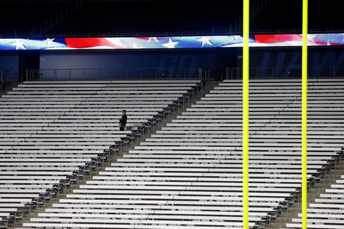 Nov 21, 2020; Seattle, Washington, USA; A person stands for the playing of the national anthem before the start of a game between the Washington Huskies and the Arizona Wildcats at Alaska Airlines Field at Husky Stadium. Mandatory Credit: Jennifer Buchanan-USA TODAY Sports