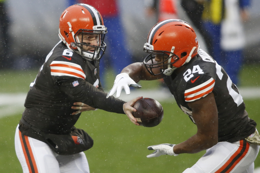 Nov 22, 2020; Cleveland, Ohio, USA; Cleveland Browns quarterback Baker Mayfield (6) hands off to running back Nick Chubb (24) during the first quarter against the Philadelphia Eagles at FirstEnergy Stadium. Mandatory Credit: Scott Galvin-USA TODAY Sports