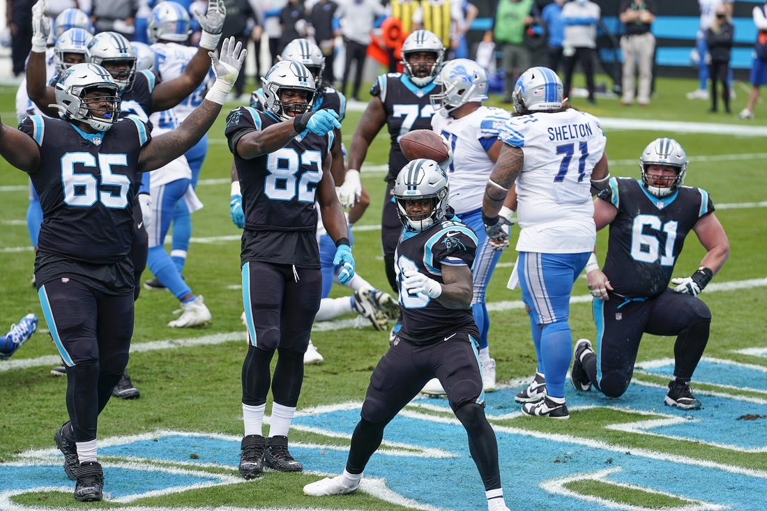 Nov 22, 2020; Charlotte, North Carolina, USA; Carolina Panthers running back Mike Davis (28) celebrates his score against the Detroit Lions with his teammates during the first quarter at Bank of America Stadium. Mandatory Credit: Jim Dedmon-USA TODAY Sports