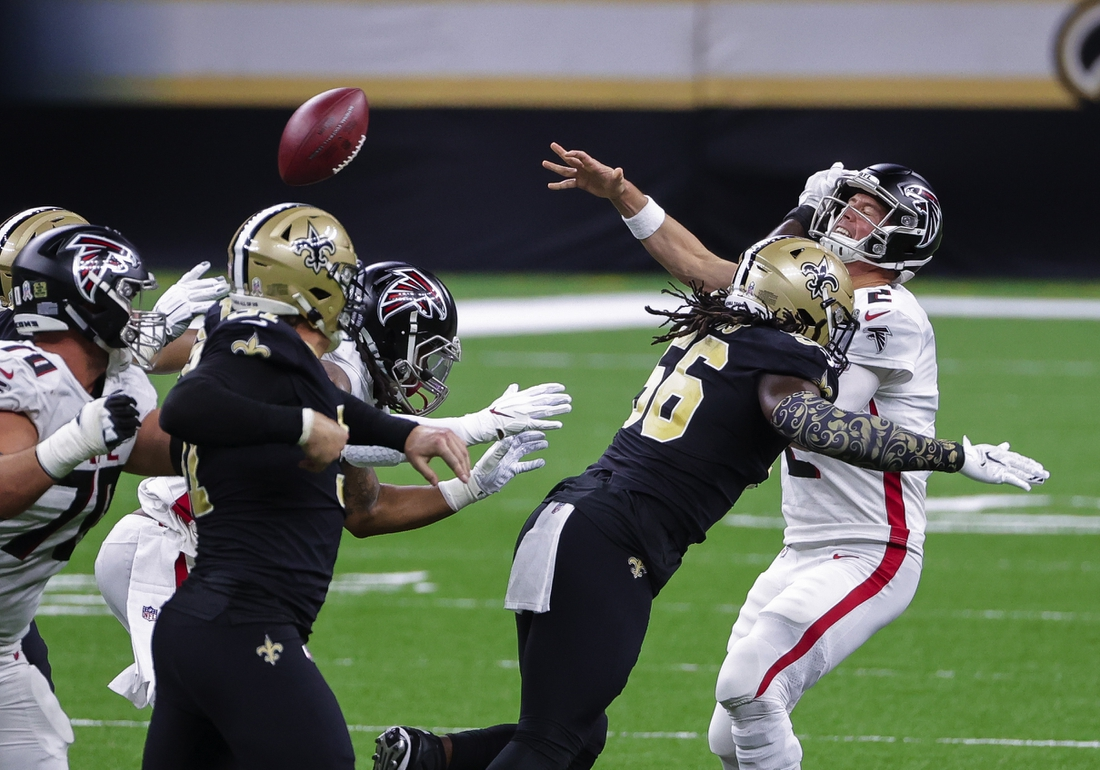 Nov 22, 2020; New Orleans, Louisiana, USA; New Orleans Saints outside linebacker Demario Davis (56) hits Atlanta Falcons quarterback Matt Ryan (2) forcing an incomplete pass during the first quarter at the Mercedes-Benz Superdome. Mandatory Credit: Derick E. Hingle-USA TODAY Sports