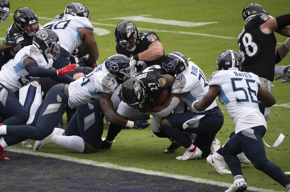 Nov 22, 2020; Baltimore, Maryland, USA; Baltimore Ravens running back J.K. Dobbins (27) dives for a second quarter touchdown against the Tennessee Titans  at M&T Bank Stadium. Mandatory Credit: Tommy Gilligan-USA TODAY Sports