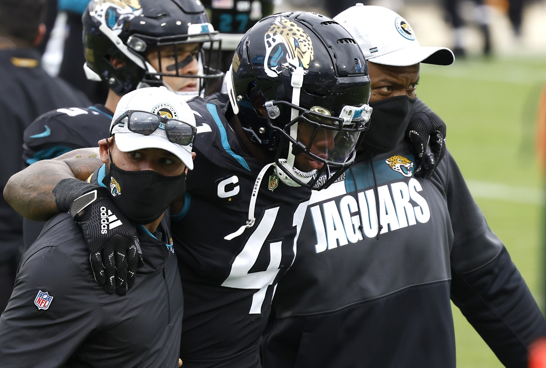 Nov 22, 2020; Jacksonville, Florida, USA; Trainers attend to Jacksonville Jaguars defensive end Josh Allen (41) during the second half against the Pittsburgh Steelers at TIAA Bank Field. Mandatory Credit: Reinhold Matay-USA TODAY Sports