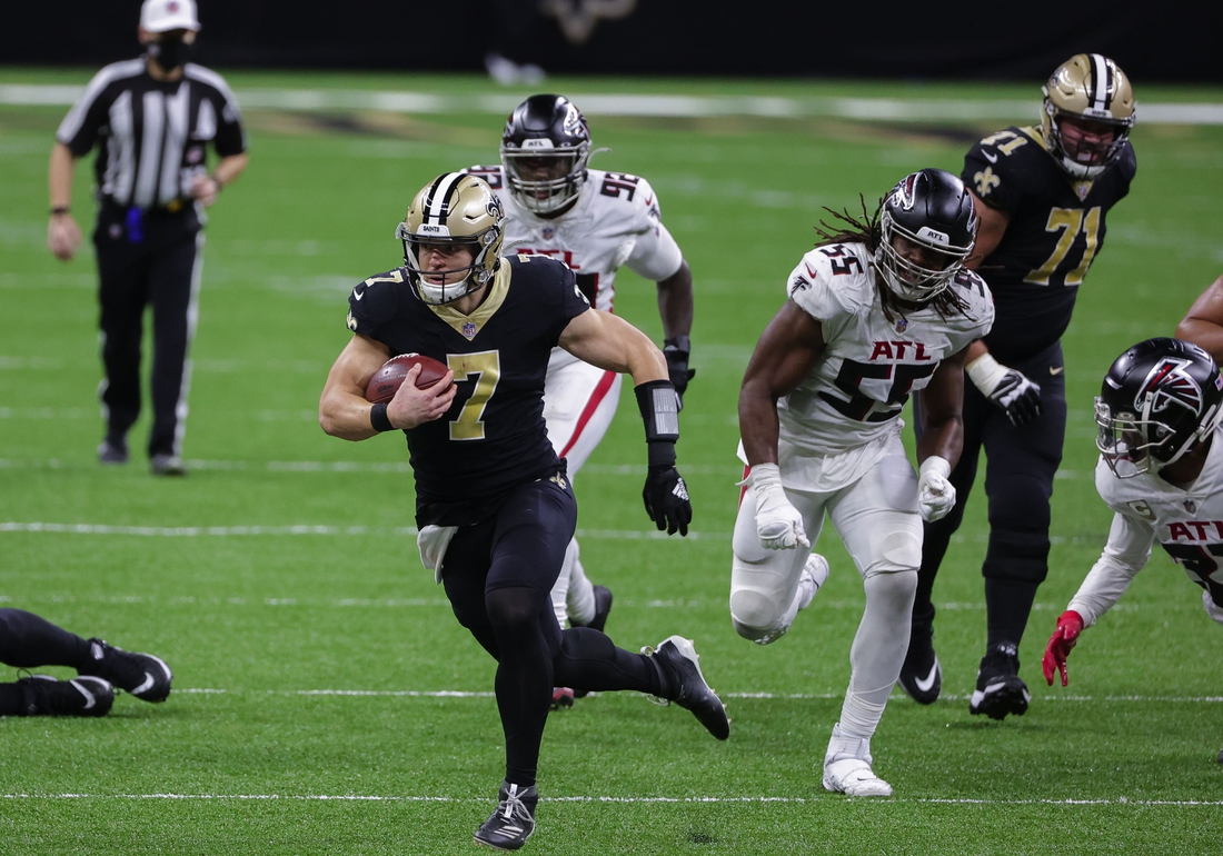 Nov 22, 2020; New Orleans, Louisiana, USA; New Orleans Saints quarterback Taysom Hill (7) runs against the Atlanta Falcons during the second half at the Mercedes-Benz Superdome. Mandatory Credit: Derick E. Hingle-USA TODAY Sports