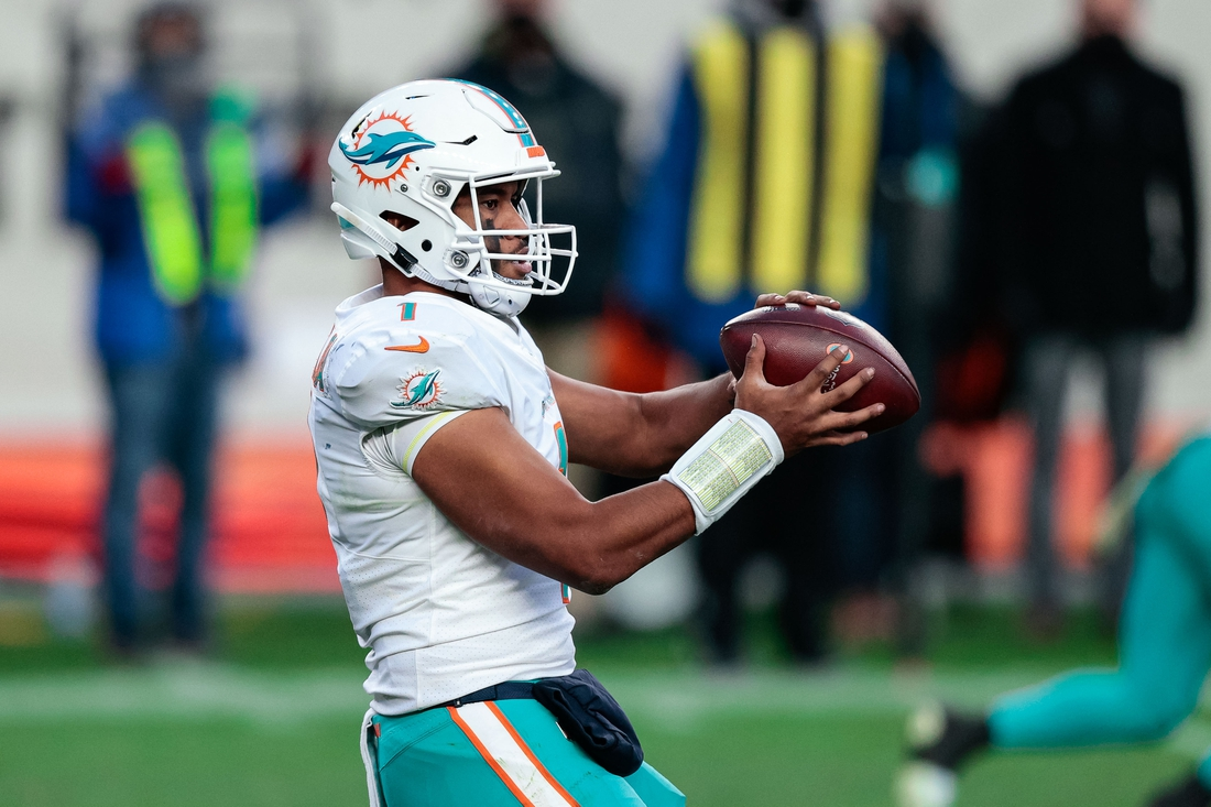 Nov 22, 2020; Denver, Colorado, USA; Miami Dolphins quarterback Tua Tagovailoa (1) takes a snap in the third quarter against the Denver Broncos at Empower Field at Mile High. Mandatory Credit: Isaiah J. Downing-USA TODAY Sports