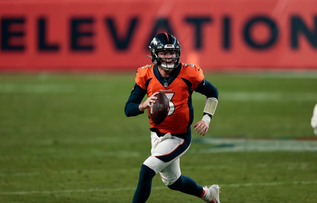 Nov 22, 2020; Denver, Colorado, USA; Denver Broncos quarterback Drew Lock (3) scrambles with the ball against the Miami Dolphins in the fourth quarter at Empower Field at Mile High. Mandatory Credit: Isaiah J. Downing-USA TODAY Sports