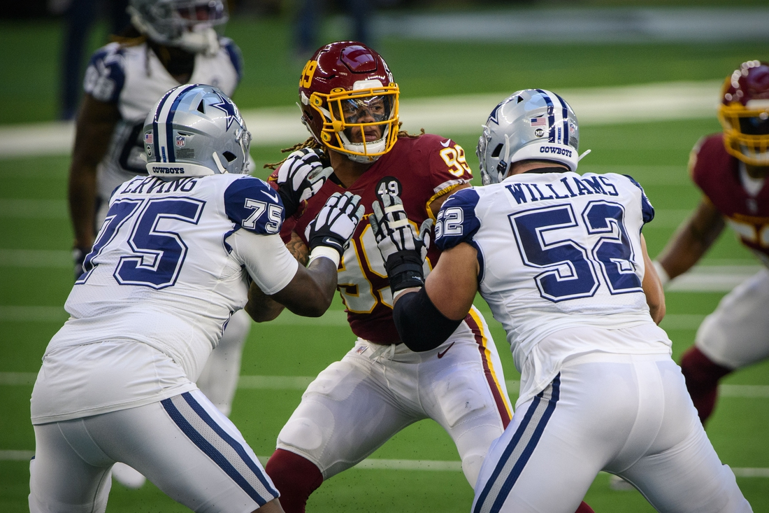 Nov 26, 2020; Arlington, Texas, USA; Washington Football Team defensive end Chase Young (99) is double teamed by Dallas Cowboys offensive tackle Cameron Erving (75) and offensive guard Connor Williams (52) during the first quarter at AT&T Stadium. Mandatory Credit: Jerome Miron-USA TODAY Sports