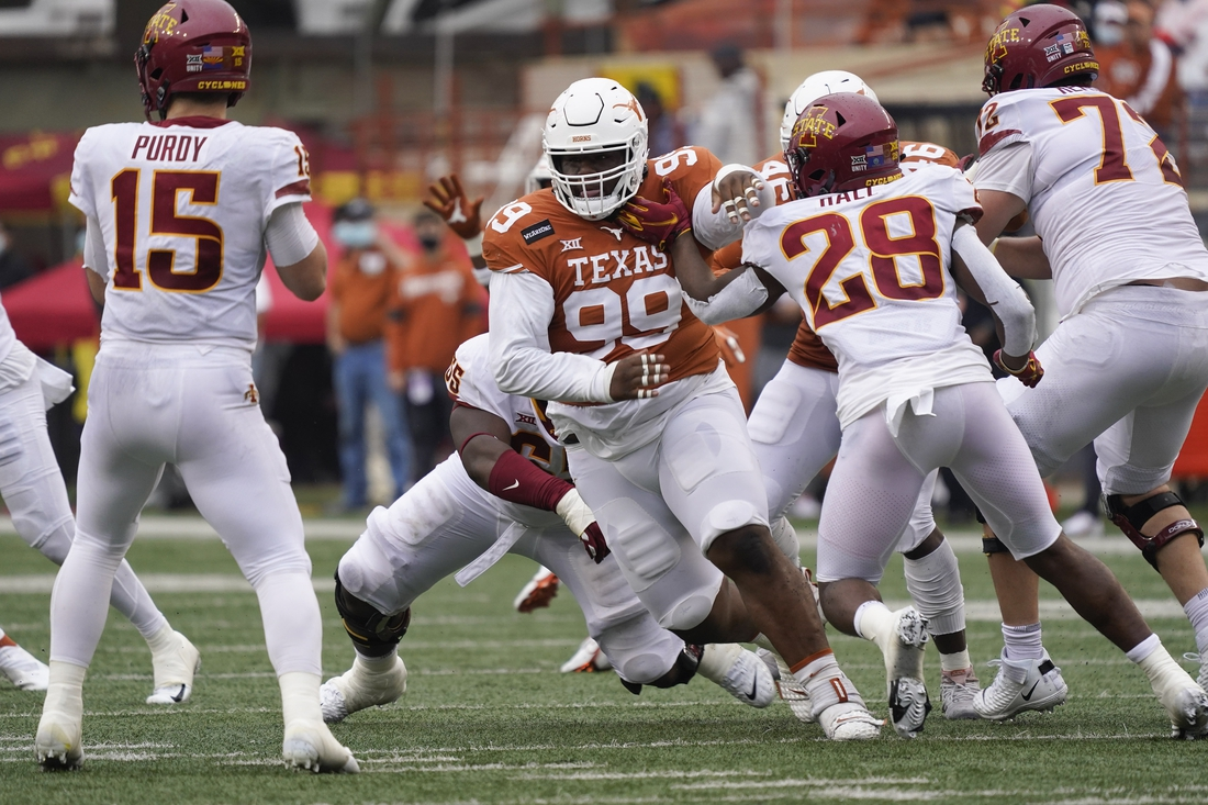 Nov 27, 2020; Austin, Texas, USA; Texas Longhorns defensive lineman Keondre Coburn (99) rushes Iowa State Cyclones quarterback Brock Purdy (15) in the second quarter at Darrell K Royal-Texas Memorial Stadium. Mandatory Credit: Scott Wachter-USA TODAY Sports