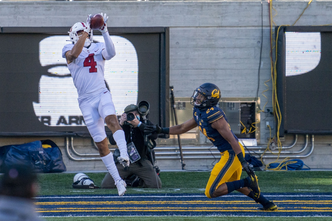 November 27, 2020; Berkeley, California, USA; Stanford Cardinal wide receiver Michael Wilson (4) catches the touchdown against California Golden Bears cornerback Camryn Bynum (24) during the second quarter at California Memorial Stadium. Mandatory Credit: Kyle Terada-USA TODAY Sports