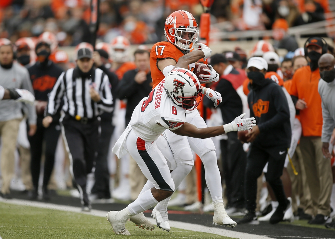 Nov 28, 2020; Oklahoma State Cowboys wide receiver Dillon Stoner (17) is pushed out by Texas Tech Red Raiders defensive back Zech McPhearson (8) during a football game at Boone Pickens Stadium. Mandatory Credit: Bryan Terry-USA TODAY Sports