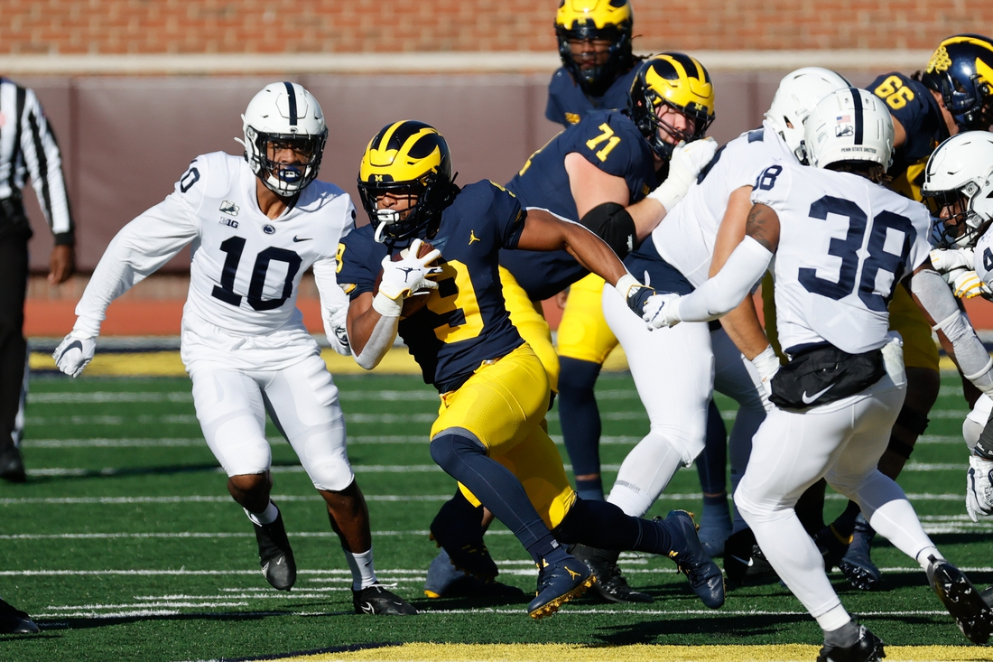 Nov 28, 2020; Ann Arbor, Michigan, USA;  Michigan Wolverines running back Chris Evans (9) rushes in the first half against the Penn State Nittany Lions at Michigan Stadium. Mandatory Credit: Rick Osentoski-USA TODAY Sports
