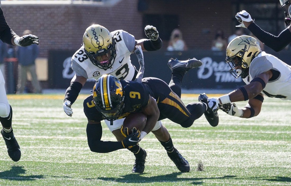 Nov 28, 2020; Columbia, Missouri, USA; Missouri Tigers wide receiver Jalen Knox (9) runs the ball against Vanderbilt Commodores cornerback Jaylen Mahoney (23) during the first half at Faurot Field at Memorial Stadium. Mandatory Credit: Denny Medley-USA TODAY Sports