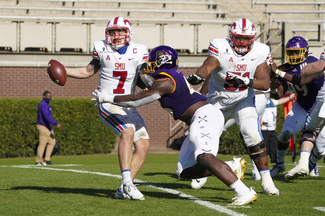 Nov 28, 2020; Greenville, North Carolina, USA; Southern Methodist Mustangs quarterback Shane Buechele (7) is chased by East Carolina Pirates defensive lineman Rick D'Abreu (45) during the first half at Dowdy-Ficklen Stadium. Mandatory Credit: James Guillory-USA TODAY Sports