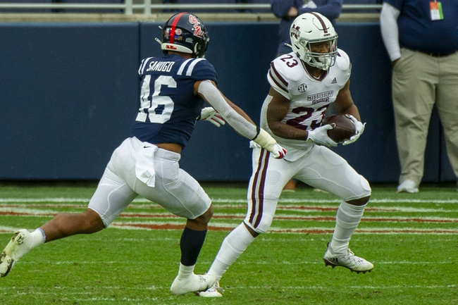 Nov 28, 2020; Oxford, Mississippi, USA; Mississippi State Bulldogs running back Dillon Johnson (23) carries the ball while defended by Mississippi Rebels linebacker MoMo Sanogo (46) during the first half at Vaught-Hemingway Stadium. Mandatory Credit: Justin Ford-USA TODAY Sports