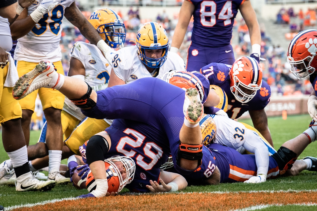 Nov 28, 2020; Clemson, SC, USA; Clemson offensive lineman Cade Stewart (62) helps push in Clemson running back Chez Mellusi (27) for a touchdown during the second quarter of the game against Pittsburgh at Memorial Stadium. Mandatory Credit: Ken Ruinard-USA TODAY Sports