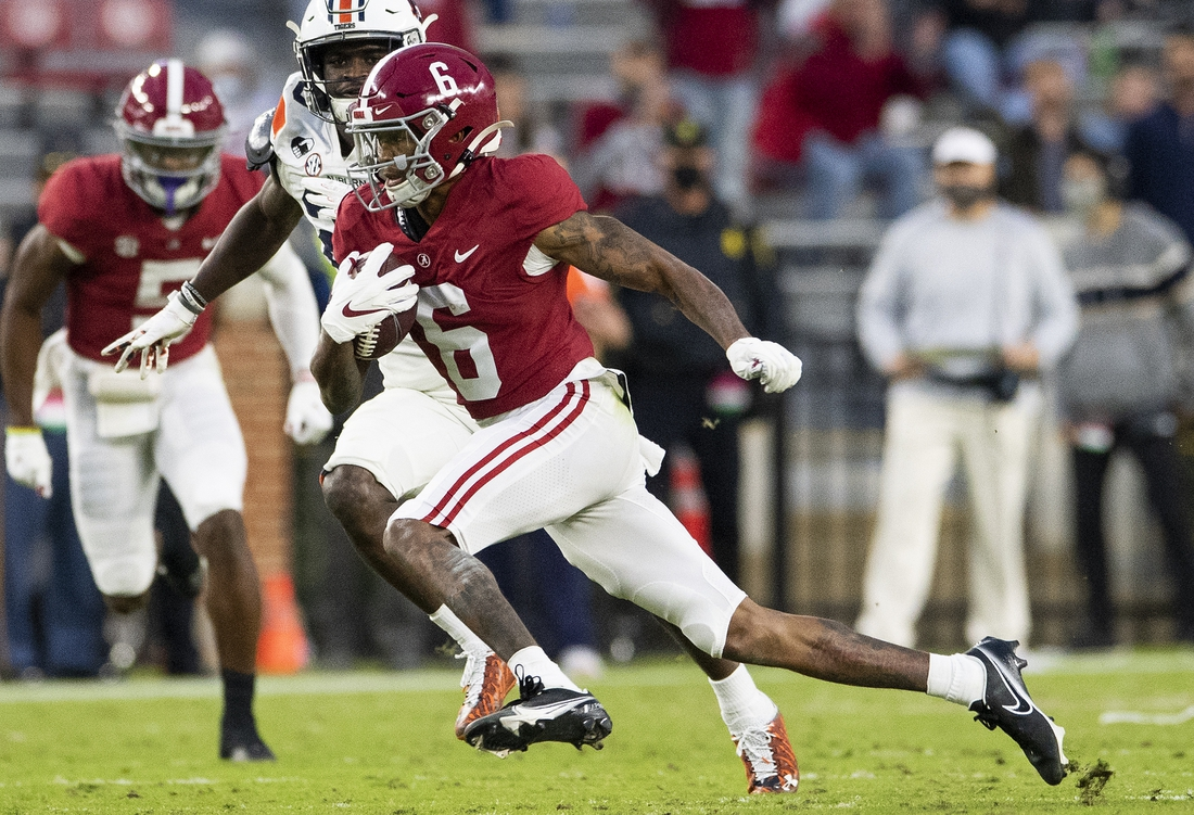 Nov 28, 2020; Tuscaloosa, Alabama, USA;  Alabama wide receiver DeVonta Smith (6) breaks free for a touchdown against Auburn at Bryant-Denny Stadium in the Iron Bowl. Mandatory Credit: Mickey Welsh/The Montgomery Advertiser via USA TODAY Sports