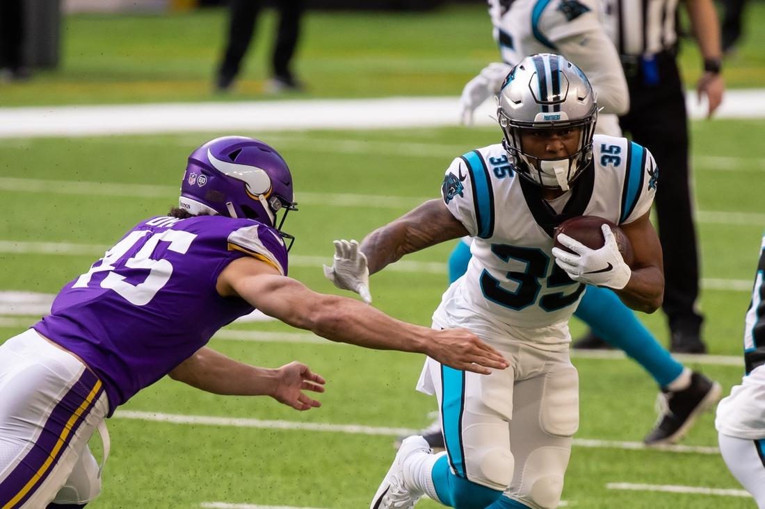 Nov 29, 2020; Minneapolis, Minnesota, USA; Carolina Panthers running back Rodney Smith (35) runs with the ball against Minnesota Vikings linebacker Troy Dye (45) in the first quarter at U.S. Bank Stadium. Mandatory Credit: Brad Rempel-USA TODAY Sports