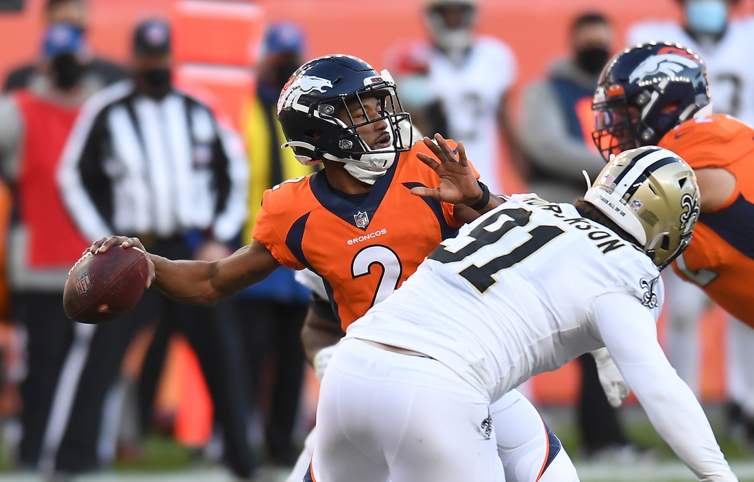 Nov 29, 2020; Denver, Colorado, USA; Denver Broncos quarterback Kendall Hinton (2) throws the ball against the New Orleans Saints in the second quarter at Empower Field at Mile High. Mandatory Credit: Ron Chenoy-USA TODAY Sports