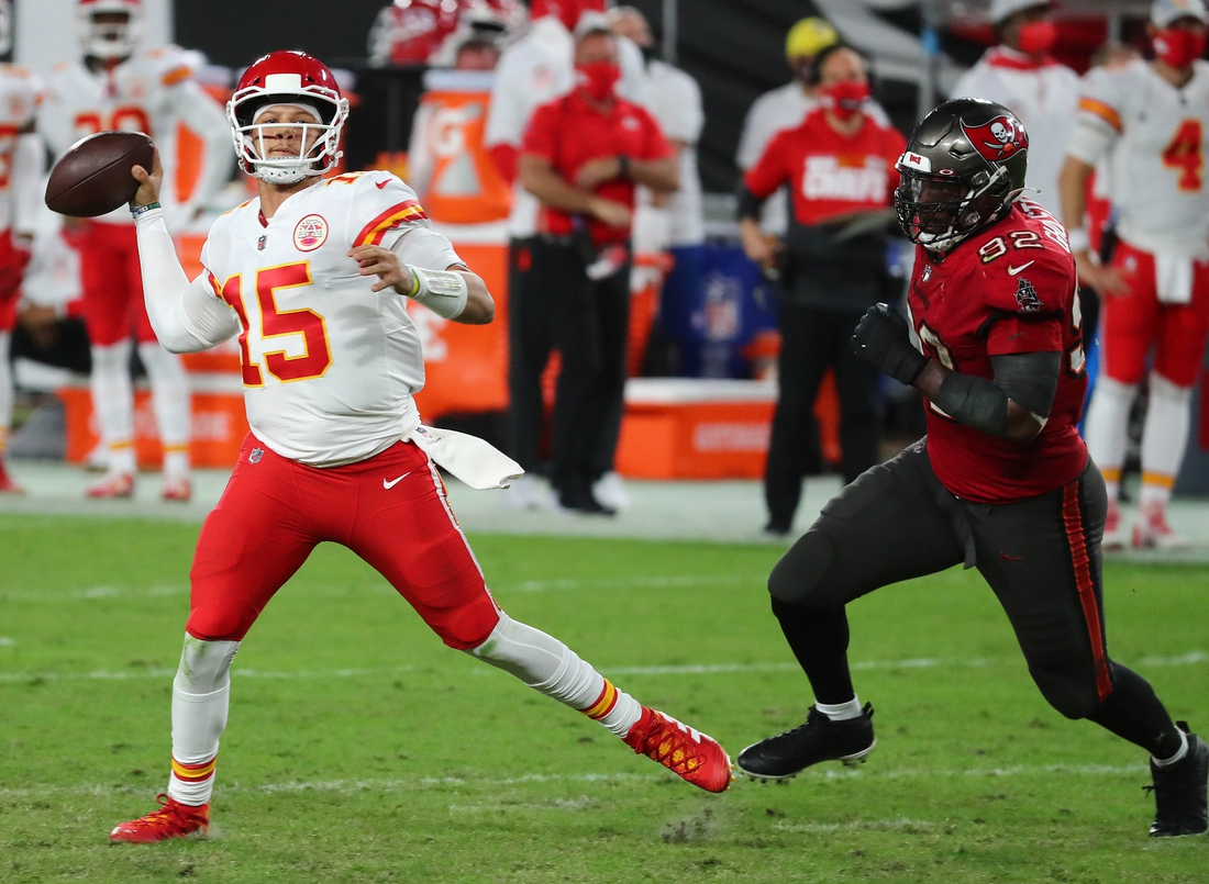 Nov 29, 2020; Tampa, Florida, USA; Kansas City Chiefs quarterback Patrick Mahomes (15) throws as Tampa Bay Buccaneers defensive end William Gholston (92) moves in during the first half at Raymond James Stadium. Mandatory Credit: Kim Klement-USA TODAY Sports
