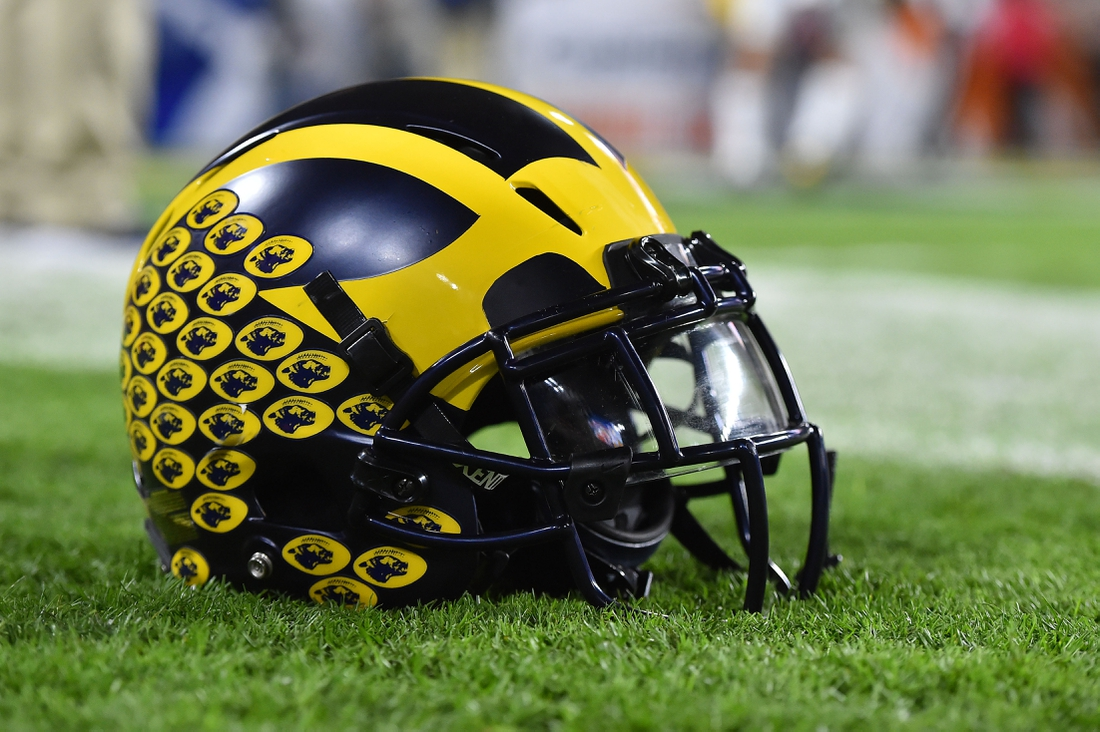 Dec 30, 2016; Miami Gardens, FL, USA;  A Michigan Wolverines football helmet sits on the field prior to the game between the Florida State Seminoles and the Michigan Wolverines at Hard Rock Stadium. Mandatory Credit: Jasen Vinlove-USA TODAY Sports