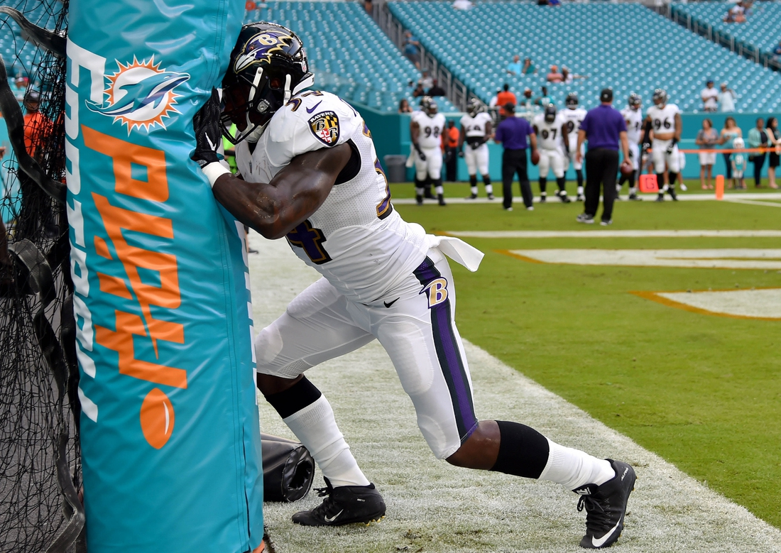 Aug 17, 2017; Miami Gardens, FL, USA; Baltimore Ravens running back Lorenzo Taliaferro (34) warms up before a game against the Miami Dolphins at Hard Rock Stadium. Mandatory Credit: Steve Mitchell-USA TODAY Sports
