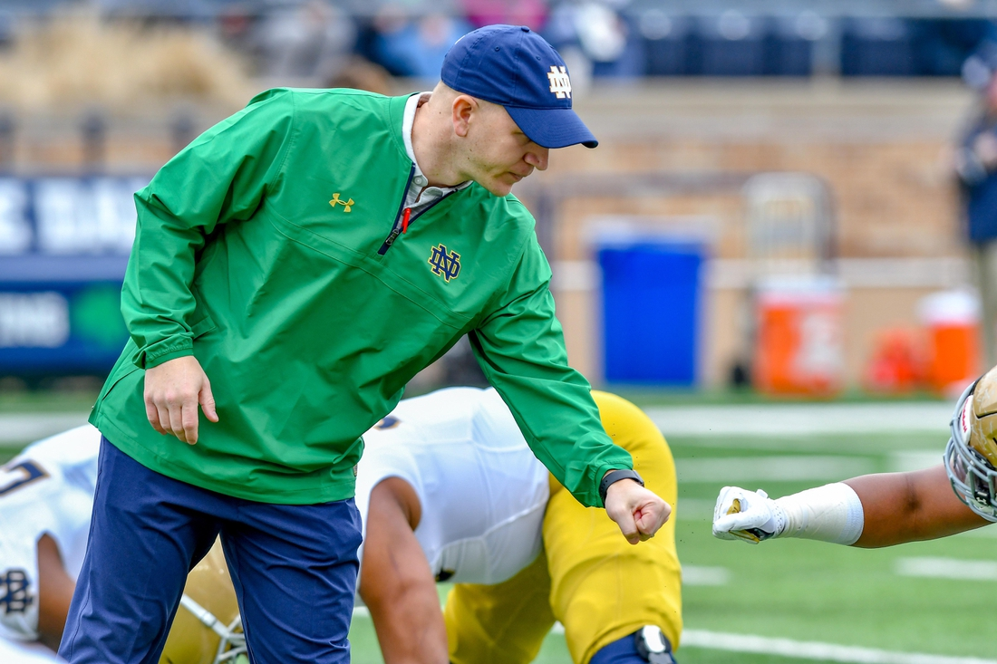 Apr 21, 2018; Notre Dame, IN, USA; Notre Dame Fighting Irish defensive coordinator Clark Lea watches warmups before the Blue-Gold Game at Notre Dame Stadium. Mandatory Credit: Matt Cashore-USA TODAY Sports