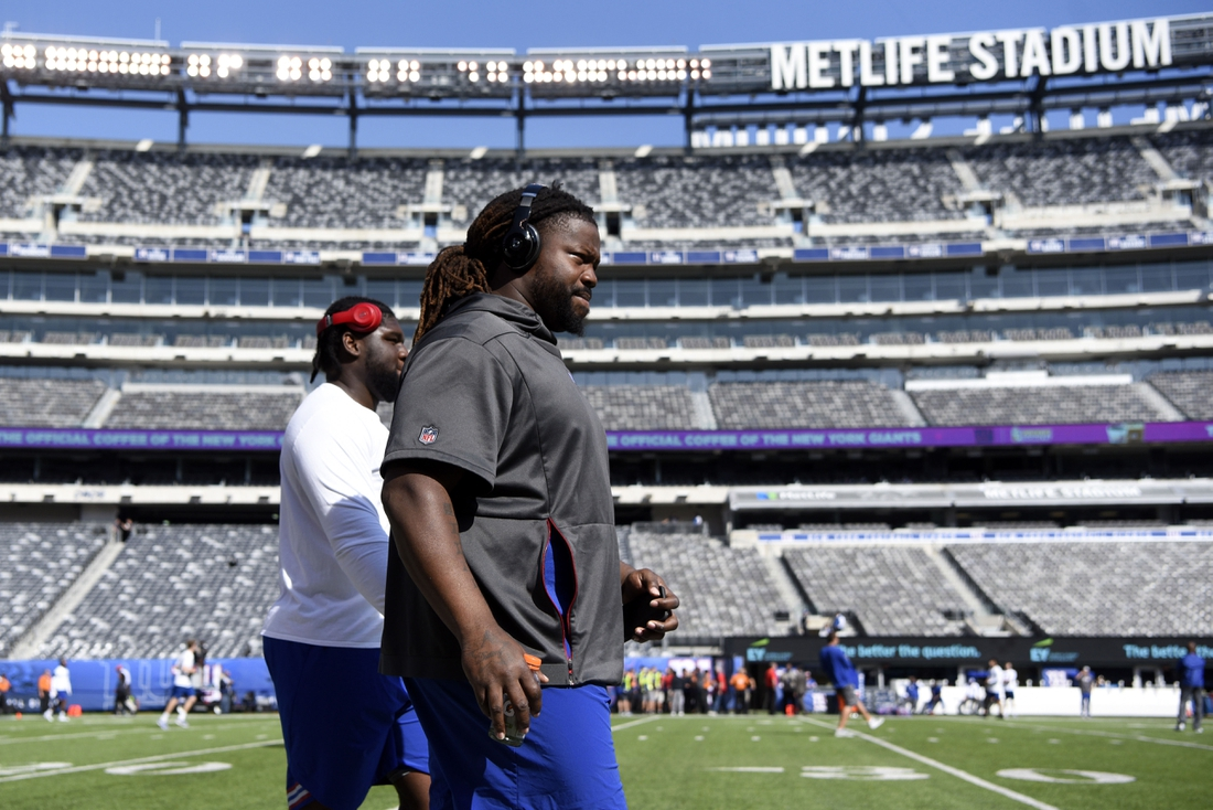 """Sep 30, 2018; East Rutherford, NJ, USA; New York Giants defensive tackle Damon """"Snacks"""" Harrison, right, walks along the field with teammate Dalvin Tomlinson before facing the New Orleans Saints at MetLife Stadium. Mandatory Credit: Danielle Parhizkaran/NorthJersey.com via USA TODAY NETWORK"""
