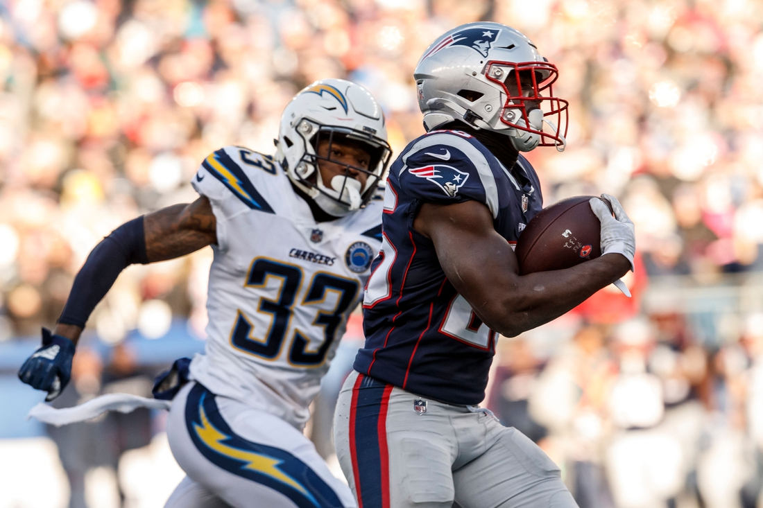 Jan 13, 2019; Foxborough, MA, New England Patriots running back Sony Michel (26) runs the ball against the Los Angeles Chargers in an AFC Divisional playoff football game at Gillette Stadium. Mandatory Credit: David Butler II-USA TODAY Sports