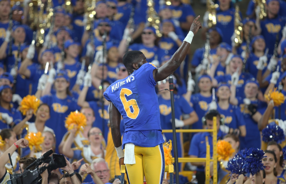 Sep 21, 2019; Pittsburgh, PA, USA;  Pittsburgh Panthers wide receiver Aaron Mathews (6) leads the PITT band in the alma mater after defeating the UCF Knights at Heinz Field. Pittsburgh won 35-34. Mandatory Credit: Charles LeClaire-USA TODAY Sports