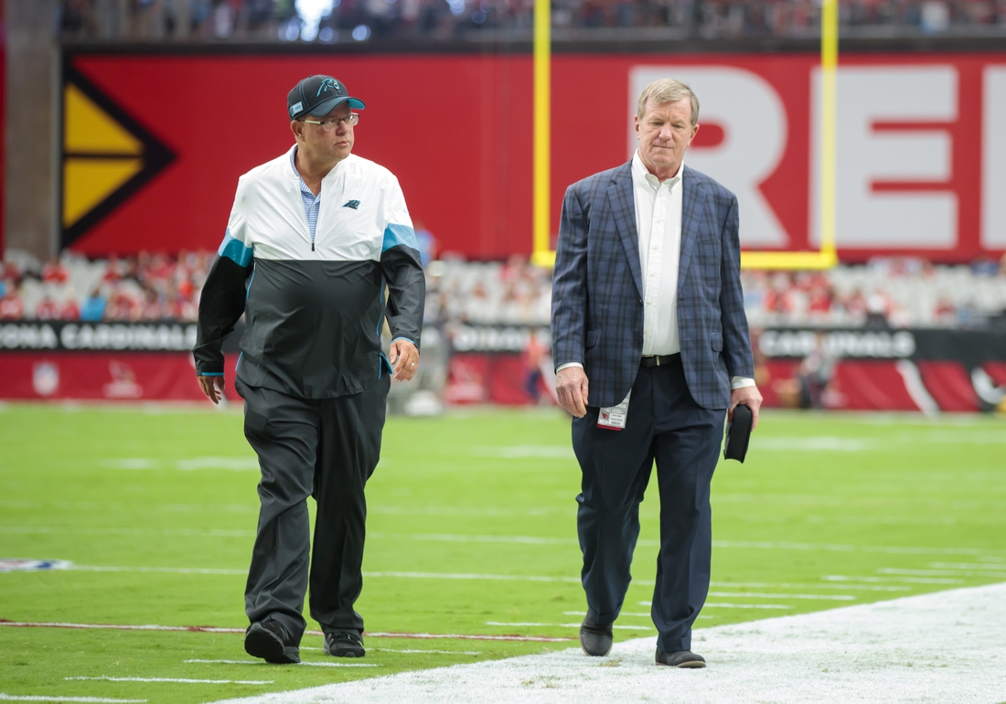 Sep 22, 2019; Glendale, AZ, USA; Carolina Panthers owner David Tepper (left) and general manager Marty Hurney on the sidelines prior to the game against the Arizona Cardinals at State Farm Stadium. Mandatory Credit: Mark J. Rebilas-USA TODAY Sports