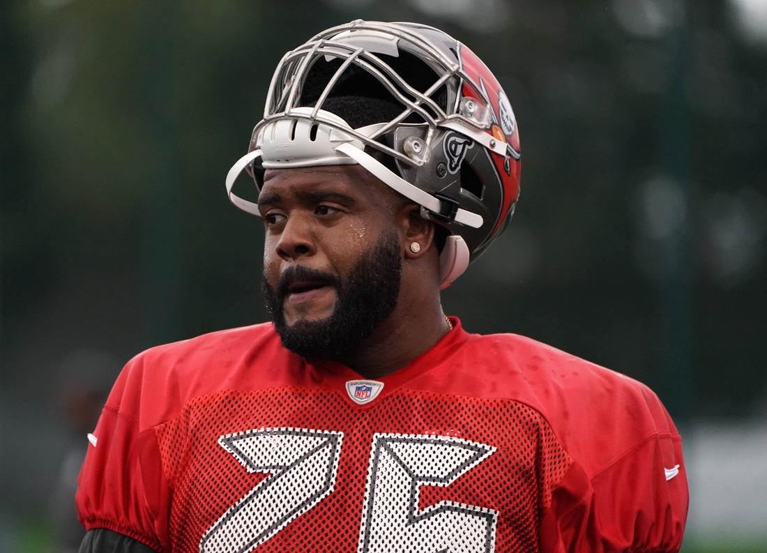 Oct 11, 2019; London, United Kingdom; Tampa Bay Buccaneers offensive tackle Donovan Smith (76) during practice at the Blackheath Rugby Club. Mandatory Credit: Kirby Lee-USA TODAY Sports