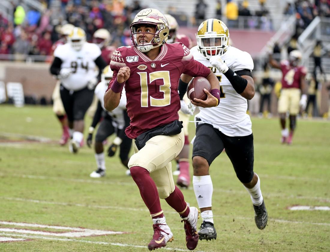 Nov 16, 2019; Tallahassee, FL, USA; Florida State Seminoles quarterback Jordan Travis (13) runs the ball during the second half against the Alabama State Hornets at Doak Campbell Stadium. Mandatory Credit: Melina Myers-USA TODAY Sports