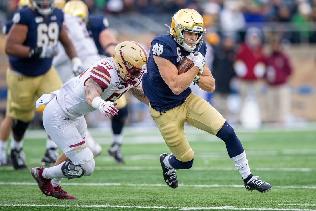 Nov 23, 2019; South Bend, IN, USA; Notre Dame Fighting Irish wide receiver Chris Finke (10) runs as Boston College Eagles linebacker Isaiah McDuffie (55) attempts to tackle in the second quarter at Notre Dame Stadium. Mandatory Credit: Matt Cashore-USA TODAY Sports