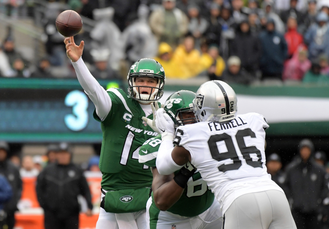 Nov 24, 2019; East Rutherford, NJ, USA; New York Jets quarterback Sam Darnold (14) throws a pass under pressure from Oakland Raiders defensive end Clelin Ferrell (96) in theh first half at MetLife Stadium. The Jets defeated the Raiders 34-3.  Mandatory Credit: Kirby Lee-USA TODAY Sports