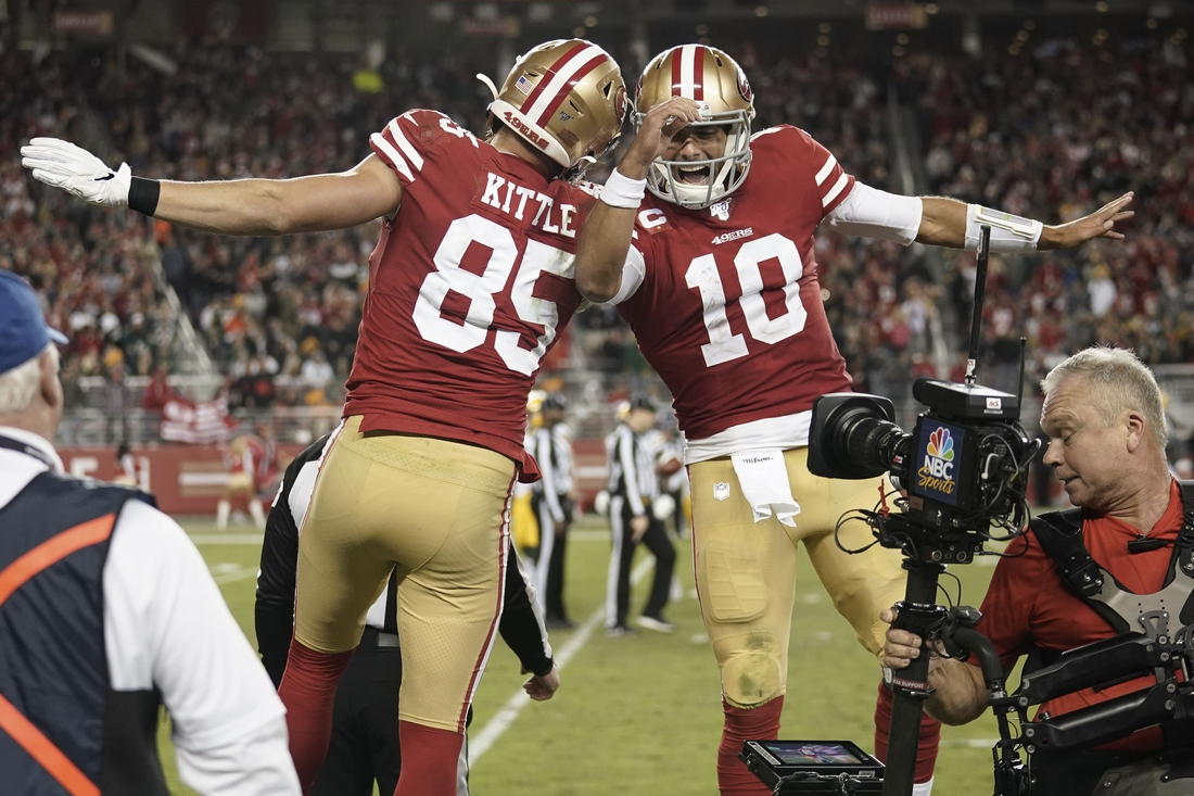 Nov 24, 2019; Santa Clara, CA, USA; San Francisco 49ers tight end George Kittle (85) and quarterback Jimmy Garoppolo (10) celebrate after scoring a touchdown against the Green Bay Packers during the third quarter at Levi's Stadium. Mandatory Credit: Stan Szeto-USA TODAY Sports