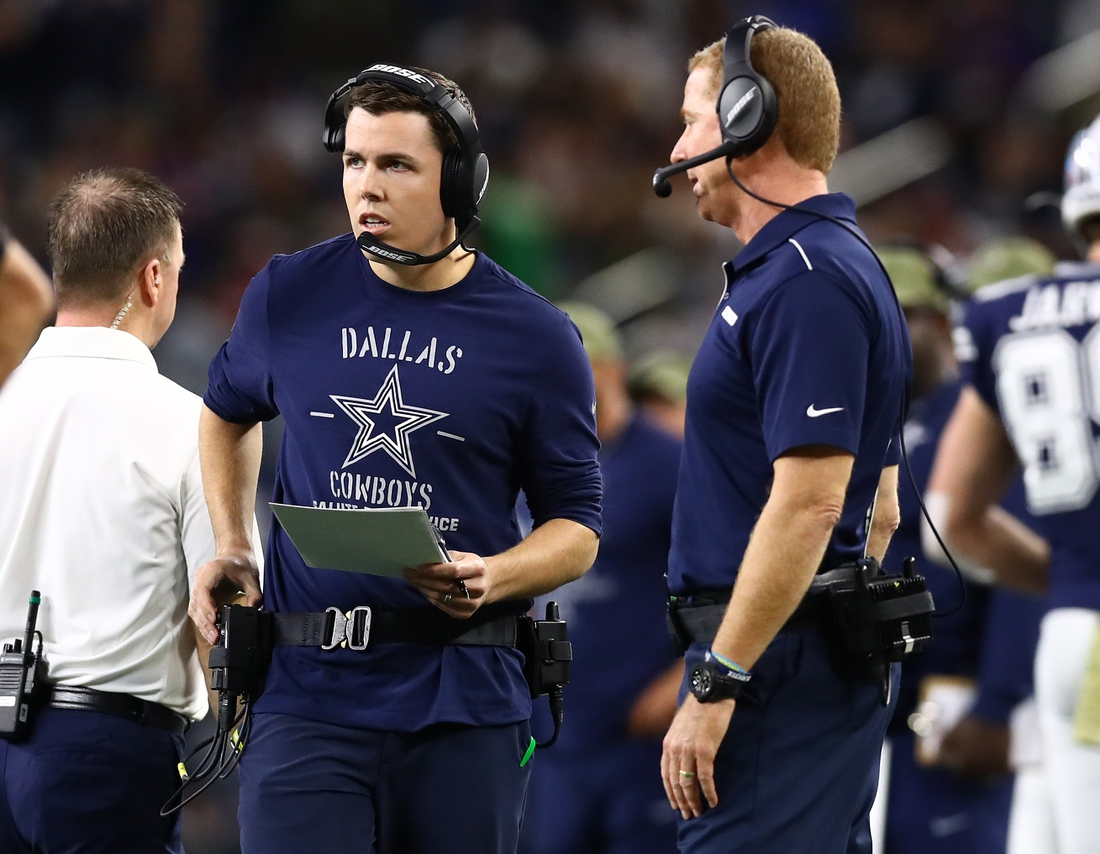 Nov 10, 2019; Arlington, TX, USA; Dallas Cowboys offensive coordinator Kellen Moore with head coach Jason Garrett on the sidelines during the game against the Minnesota Vikings at AT&T Stadium. Mandatory Credit: Matthew Emmons-USA TODAY Sports