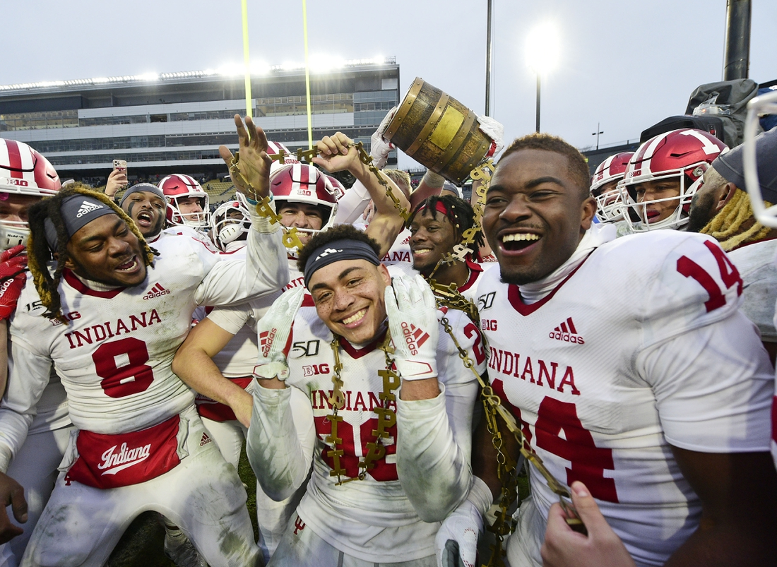 Nov 30, 2019; West Lafayette, IN, USA; Indiana Hoosiers players celebrate winning the Old Oaken Bucket by defeating the Purdue Boilermakers, 44-41 in 2 OT at Ross-Ade Stadium. Mandatory Credit: Thomas J. Russo-USA TODAY Sports