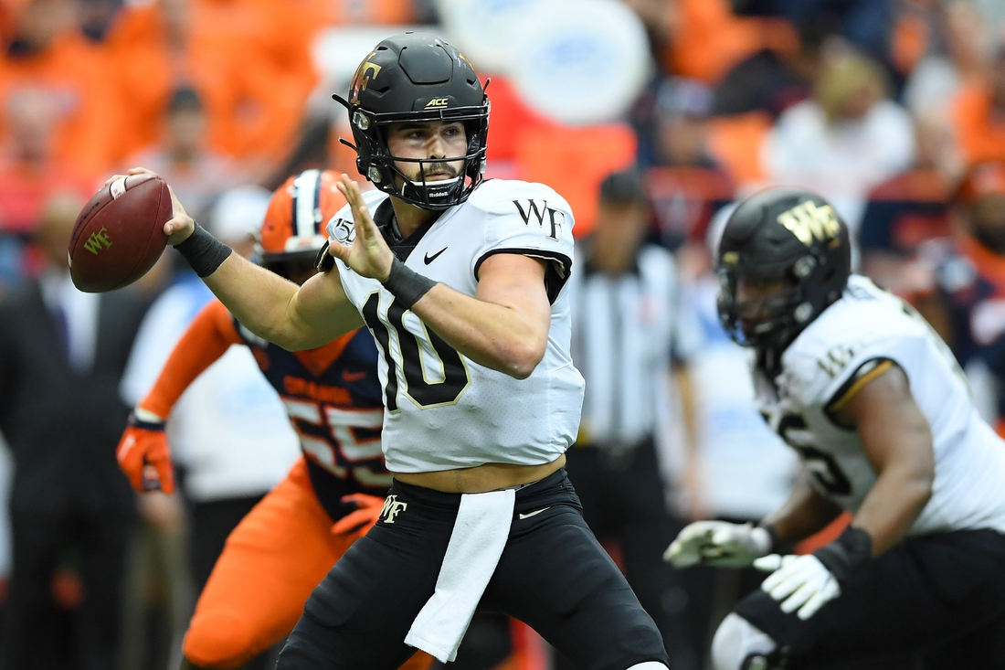 Nov 30, 2019; Syracuse, NY, USA; Wake Forest Demon Deacons quarterback Sam Hartman (10) passes the ball against the Syracuse Orange during the second quarter at the Carrier Dome. Mandatory Credit: Rich Barnes-USA TODAY Sports