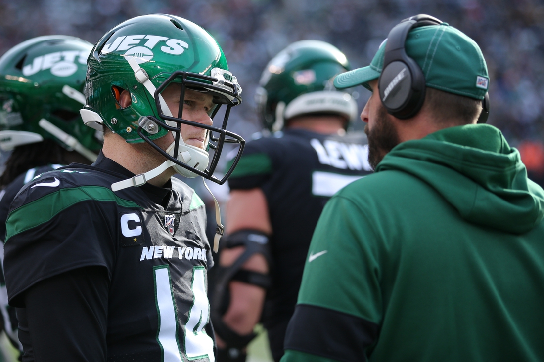 Dec 8, 2019; East Rutherford, NJ, USA; New York Jets quarterback Sam Darnold (14) talks to head coach Adam Gase during the first quarter against the Miami Dolphins at MetLife Stadium. Mandatory Credit: Brad Penner-USA TODAY Sports