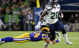 Dec 8, 2019; Los Angeles, CA, USA; Los Angeles Rams safety Taylor Rapp (24) makes a diving tackle on Seattle Seahawks running back Rashaad Penny (20) in the first quarter  at Los Angeles Memorial Coliseum. Mandatory Credit: Robert Hanashiro-USA TODAY Sports