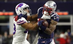 Dec 21, 2019; Foxborough, Massachusetts, USA; New England Patriots wide receiver N'Keal Harry (15) tries to break free from Buffalo Bills outside linebacker Matt Milano (58) during the first quarter at Gillette Stadium. Mandatory Credit: Winslow Townson-USA TODAY Sports
