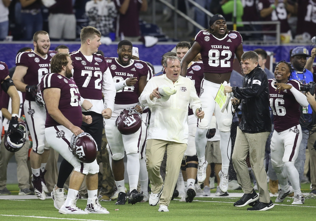 Dec 27, 2019; Houston, Texas, USA; Texas A&M Aggies head coach Jimbo Fisher reacts after getting a Gatorade bath after defeating the Oklahoma State Cowboys in the fourth quarter at NRG Stadium. Mandatory Credit: Thomas Shea-USA TODAY Sports